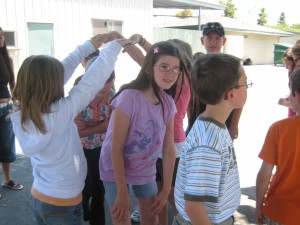 Campers learn traditional dances and songs.