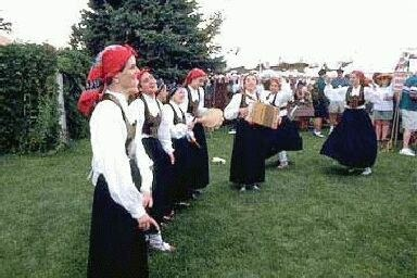 "Chino's ""Euskal Giroa"" group members dancing and singing at a Basque festival in Boise"