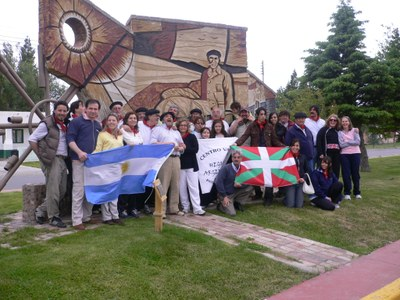 Members of the Hegoalde Argentinarra Basque Center at the Patagonian monument to Guillermo Larregui