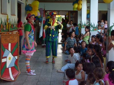 Clowns performing in a children activity organized by the Kotoiaren Lurra Basque Club of Chaco