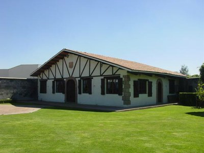 Headquarters of the Celaya Basque association, that includes the Basque farm style building, a green area and gardens, and a Basque handball or pelota court (photo EuskalKultura.com)