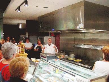 "Dan Ansotegui in his ""The Basque Market"" shop's kitchen at one of his Basque cuisine tasting-exhibits"