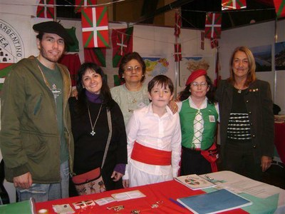 Members of the Gure Etxea Basque Club of Santa Fe at the center's stand at the local Communities' Fair