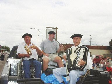 Edu Sarria in the middle playing txistu, Jim Jausoro on the right playing accordion and Juan Zulaika on the left playing tambourine in Elko Basque parade