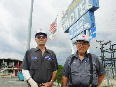 Richard and his brother Aiden Madariaga from Oregon at their Jordan Valley motel and gas station with the American and Basque flags (ikurriña) in the background