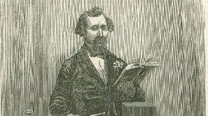 El autor inglés, con un ejemplar de 'Dombey e hijo'
