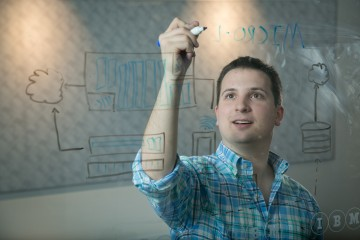 IBM software engineer Jeremy Greenberg, 23, sketches out a patent he has pending at the company's headquarter's in Research Triangle Park, NC. (Jared Lazarus/Feature Photo Service for IBM)